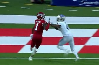 Fresno State's Keric Wheatfall gets his helmet knocked off during an 11-yard receiving touchdown, leads Nevada 21-10